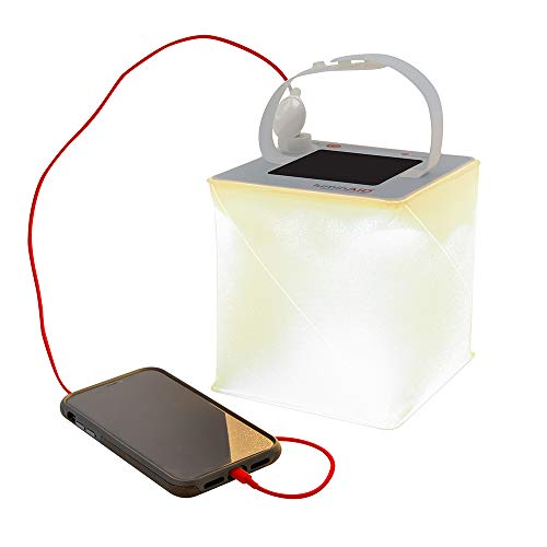 Photo of a white and orange colored LuminAID PackLite 2-in-1 Solar Lantern & Charger