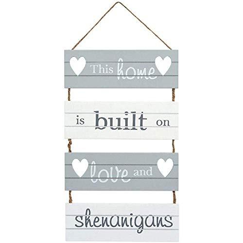 Transomnia Letrero colgante con listones 'Esta casa está construida sobre el amor y las travesuras'