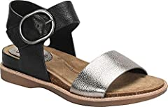 Offered in Italian leather with metallic leather Adjustable buckle with hidden hook-and-loop strap Cushioned cork comfort footbed Lightweight, flexible TPR outsole with leather welt