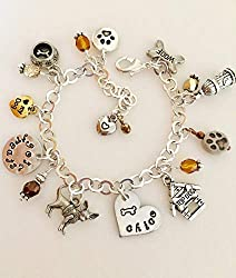 A charm bracelet with lots of dog-themed charms, photo