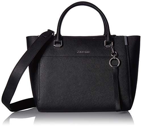 The combination leather and synthetic construction puts together a luxe look with the Calvin Klein® Raelynn Saffino Satchel handbag. Magnetic snap closure with dual carry handles and a removable crossbody strap. Exterior boasts brand detail and slip ...
