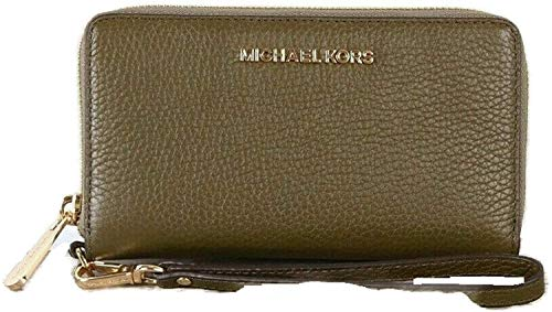 Made of Pebbled leather with logo detail on front; Zip around for closure; 01 ID slot 05 credit card slots; 1 slide pocket; Iphone slot; Full leather lining 7 inches removable leather wristlet strap; Gold hardware Measurements: Length: 7 x Height: 4 ...