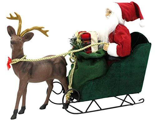 Grande Babbo Natale sulla slitta con renna carro di Natale che tiene regali di Natale