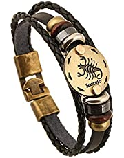The constellations bracelet made of leather decorated with wooden and metal beads and a bronze plate inscribed with the