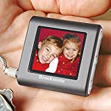 BROOKSTONE PICTURE BOOK MINI DIGITAL PHOTO KEY CHAIN - HOLDS 56 COLOR PHOTOS, BUILT IN 8 MB OF MEMORY, AUTO RESIZE PHOTOS TO FIT SCREEN, HIGH RESOLUTION 1.4' LCD COLOR SCREEN,RECHARGABLE BATTERY 2.5 HOURS OF VIEWING TIME,FAST EASY DOWNLOADS FROM PC,OR MAC, WITH INCL.SOFTWARE, CONNECTS TO COMPUTER WITH USB CORD