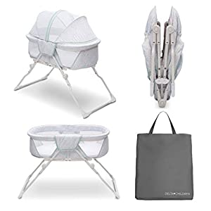 Delta Children EZ Fold Ultra Compact Travel Bedside Bassinet – Folding Portable Crib with Removable Canopy, Mirage