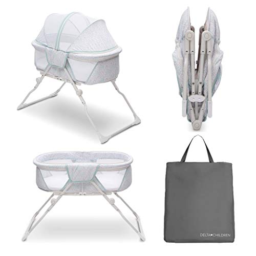 Delta Children EZ Fold Ultra Compact Travel Bedside Bassinet - Folding Portable Crib with Removable Canopy, Mirage