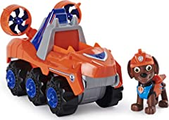 REV UP MOTOR AND WORKING TOOL: Zuma's dinosaur-inspired deluxe vehicle is ready for awesome dino rescues, with large wheels, a rev up motor and working tool! Rev it forward and watch it go! COLLECTIBLE ZUMA FIGURE: Wearing his orange and blue Dino Re...