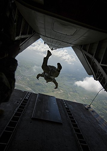 Philippine Army soldier jumps from a CH-53E Super Stallion Poster Print (23 x 33)