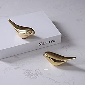 2 Pack ,size about 4LX1.8WX1.9H inch for each. Cast and handicraft with the material of brass,Gold color. Looks cute and smooth by using surface polished craft,you will never get hurt. A good mental bird artwork for living room ,also a cute bird gift...