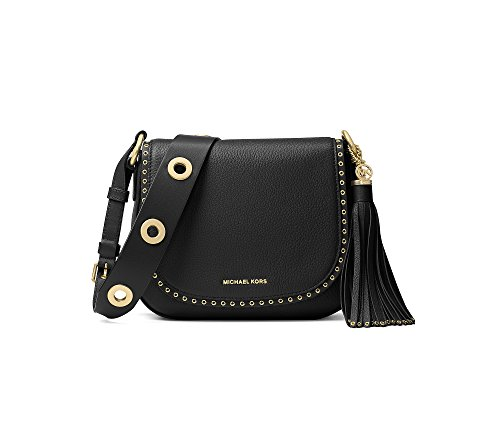 "High-shine grommets punctuate MICHAEL Michael Kors's of-the-moment saddle bag cast in soft Venus leather and finished with a swishy tassel for effortless boho styling. 24""L adjustable strap Snap closure Exterior features logo lettering and tassel acc..."