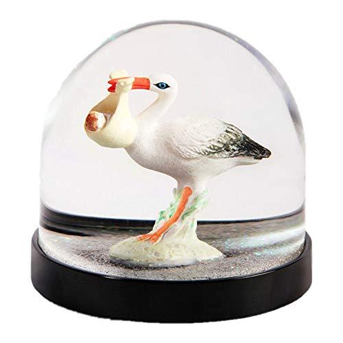 Divertida bola de nieve de alta calidad con cigüeña y purpurina en blanco, 8 x 8,5 cm de diámetro