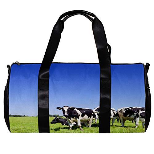 Bolsa de deporte redonda con correa de hombro desmontable para vacas en un campo de hierba bolsa de entrenamiento para mujeres y hombres
