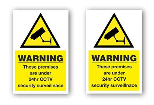 """Aufkleber mit englischsprachiger Aufschrift: """"Warning these premises are under 24hr CCTV security surveillance"""""""