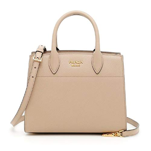 This classy Prada Bibliothèque handbag is absolutely gorgeous. This designer handbag is so unique and is shaped so beautifully. The side of this handbag is rippled pinched together leather and looks very elegant. The two toned maroon and beige trim i...