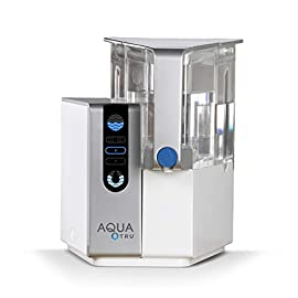 AQUA TRU Countertop Water Filtration Purification System with Exclusive 4 - Stage Ultra Reverse Osmosis Technology (No Plumbing or Installation Required) | BPA Free 6 <p>IS YOUR WATER SAFE TO DRINK? Studies continue to pour in regarding Toxins, Hormones, Microplastics, Cancer-linked Carcinogens and other contaminants discovered in our Tap Water, Filtered Water…and yes, even Bottled Water. Arsenic, lead, chromium, and drug residues are commonly found in municipal drinking water. AQUA TRU ultra pure reverse osmosis water filter system is CERTIFIED to remove such contaminants and many more! CERTIFIED to NSF Standards by IAMPO to remove 15X more contaminants than the leading pitcher filters --- removing such poisons as Lead 99.1%, Chromium 97.2%, Copper 95.2%, Fluoride 93.5%, Radium 96.4%, and Chlorine 96.6% (to name a few). In fact, its designed to remove 1000's of pollutants that could be lurking in your tap water. Taste the Difference! NO PLUMBING OR INSTALLATION required - takes less than 3 minutes to set up. AquaTru's Trusted & warranted RO countertop system COSTS CONSIDERABLY LESS than fully installed under-the-counter RO systems, while at the same time, delivering often Cleaner, Purer, and Better Tasting Water. Why waste money & landfills on bottled water (93% recently found to contain micro-plastics). Always make sure that the area where the tank meets the base is completely dry before placing the tank back onto the unit QUICK CHANGE TWIST AND SEAL FILTERS come included with your first AQUA TRU system, and last from 6 months to 2 years. SLEEK COMPACT DESIGN - 14'' Tall x 14'' Deep x 12'' Wide - Purifies 1 gallon of tap water into bottle-quality water in 12-15 minutes. 100% SATISFACTION GUARANTEED - Many popular water filters and water purifier systems claim to turn dirty water 'pure', but unfortunately, leave numerous serious chemicals and contaminants behind. With AQUA TRU, you can feel confident that you are getting ULTRA-PURE WATER from a reverse osmosis system that has undergone extensive analysis, tests and certifications.</p>
