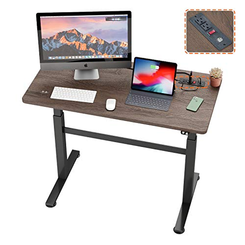 Bestier Standing Electric Sit Home Office Desk 47.7 inch Adjustable Standing Computer Desk with Safe Socket of USB Ports and Outlets Desk for Office Studying Exhibition