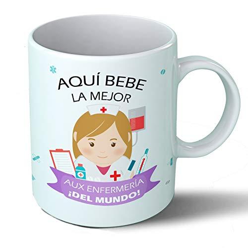 Planetacase Taza Desayuno Aquí Bebe la Mejor Auxiliar de enfermeria del Mundo Regalo Original Ceramica 330 mL