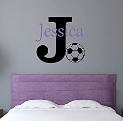 A Jessica Personalized Girls Soccer Wall Decor Above a Bed on The Wall