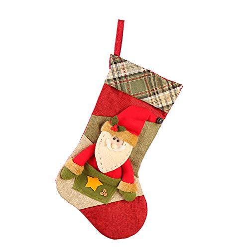 Sehr schöne kleine Tasche mit Süßigkeiten oder einem kleinen Geschenk, platziert auf den Tannenfüßen oder sogar auf einer Tanne