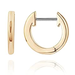 "A Hollywood favorite, huggies are one of the biggest jewelry trends right now! At just under 1/2"" in diameter, these earrings are perfect for every day and night wear, and can also be worn in a second hole. These stunning tiny hoop earrings are plate..."