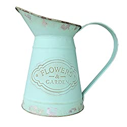 Vintage metal pitcher used as Farmhouse style decor in the kitchen.