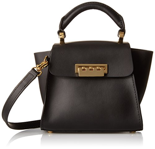 Mini handbag in structured silhouette featuring flared side gussets and hardware feet Single top handle and removable/adjustable cross-body strap