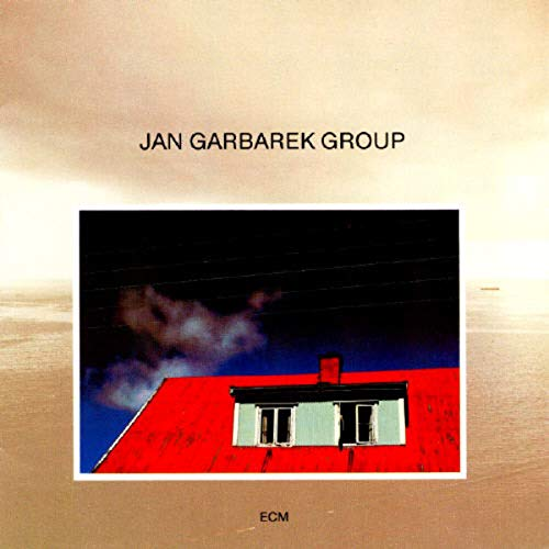 Photo with blue sky, white cloud, wires, windows and a red roof (Vinyl-LP)