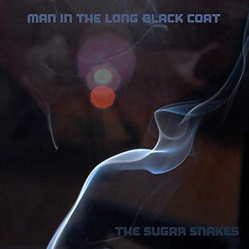 Man in the Long Black Coat