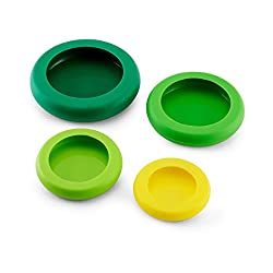 Image of four multicolored silicone food huggers, easy to use food containers