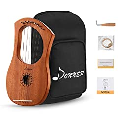 High quality wood-Made by solid mahogany resonance box and carbon steel keys to make sure the sound is better. High density black gig bag can play a good role in protection. Seven-string Design-1(D4), 2(E4), 3(G4), 4(A4), 5(B4), 6(D5), 7(E5), Classic...