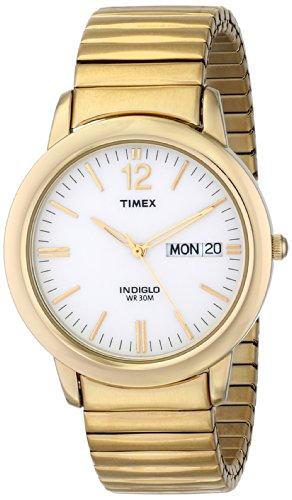reloj dorado fabricante Timex