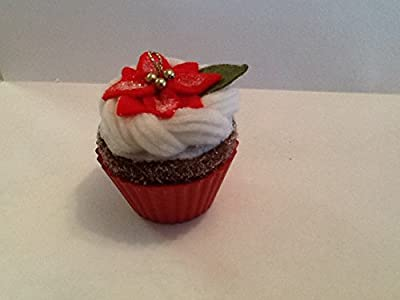 Fabric cupcake ornament with red liner and white icing and a red poinsettia on top