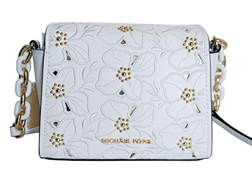 """Vanilla smooth leather with stitched and studded floral patents, golden hardware Top magnetic snap closure Inside: MK signature fabric lining, 3 slip pockets Adjustable Strap: 21""""-24.5"""" 8.5""""W X 5.5""""H X 3""""D"""