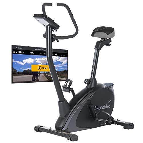 Skandika Ergometer Vinneren Design Hometrainer | Fitness Fahrrad mit Magnetbremssystem, 11kg Schwungmasse, 12 Trainingsprogramme, Tablet-Halterung, Bluetooth und App-Steuerung | grau/schwarz