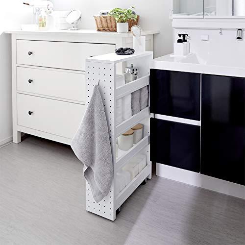 """洗濯機横の""""すきま""""には、スリムなラックもおすすめです。キャスター付きで引き出せるタイプなら、使いやすく掃除もしやすいので便利ですよ。"""