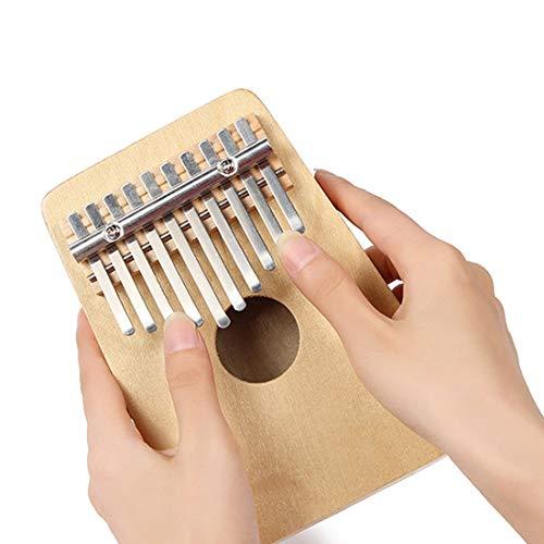 Kalimba, instrumento tradicional africano que se toca con los dedos pulgares, es divertido, está hecho a mano y tiene 10 teclas