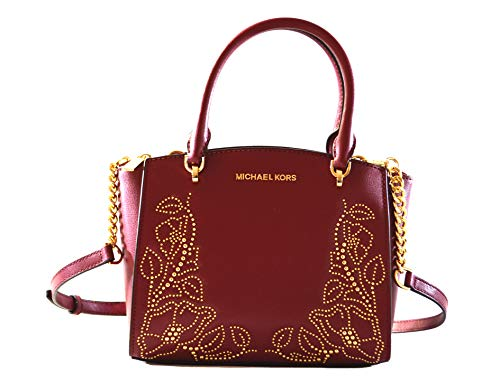 """Made of leather with gold toned studs in flower shape Removable, adjustable crossbody strap 3 Separate compartments to easily organize your daily essentials 7 slip pockets and 1 zipped pocket in the middle zipped compartment. 10""""L x 7.5""""H x 3.5""""D"""