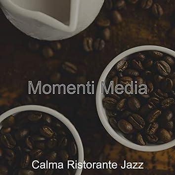 Momenti Media