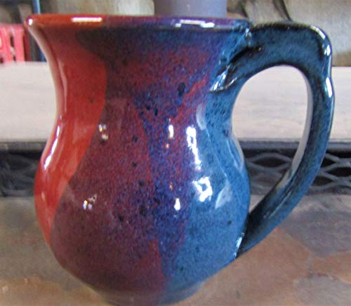 Coffee mug with thumb rest pottery