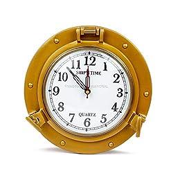 Nagina International 9 Antique Brass Finished Premium Nautical Wall Decor Vintage Time's Clock | Pirate's Porthole Decorative Clock (Quart'z Roman Dial)