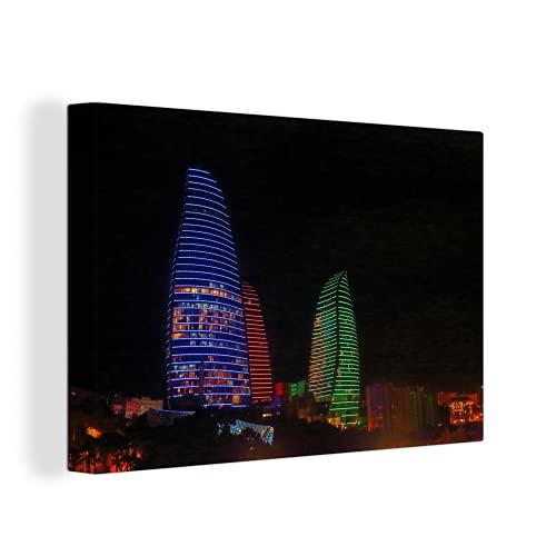 Leinwandbild - Die Flammentürme in Baku in den Farben der aserbaidschanischen Flagge - 140x90 cm