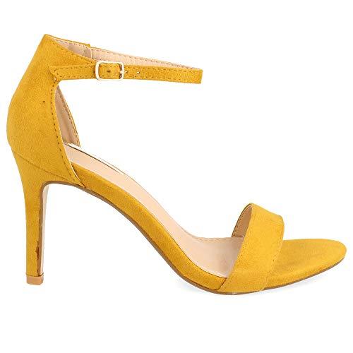Sandalias amarillas de tacón fino con pulsera