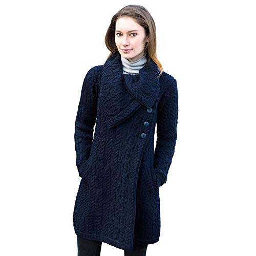Wrap up with this beautifully handcrafted Merino wool Aran coat. This beautiful knit coat comes with a chunky fold over collar to keep extra warm on cold winter days, along with two convenient pockets and a three-button closure. Available in a variet...