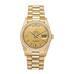 Rolex Day-Date (18238) self-winding automatic watch features a 36mm 18k yellow gold case surrounding a champagne linen dial on an 18k yellow gold President bracelet with folding buckle. Functions include hours minutes seconds day and date. This watch...