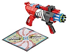 A child\'s toy gun with a target board beside it.