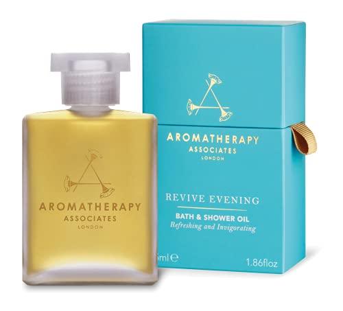 Aromatherapy Associates Revive Evening Aceite de baño y ducha de 55 ml, formulado para recuperar la confianza en uno mismo y la energía. Con una infusión de aceites esenciales de Madagascar Ylang Ylang para ayudar a disolver la ansiedad.