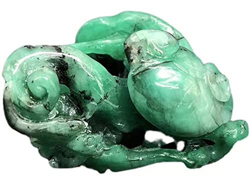 The Natural Emerald ruyi Carved Piece, The Size is 4.2X2.8X2.7MM, 15.5 Grams, which Means Good Luck and Good Deeds. It can be Given as a Gift on Any Festival.