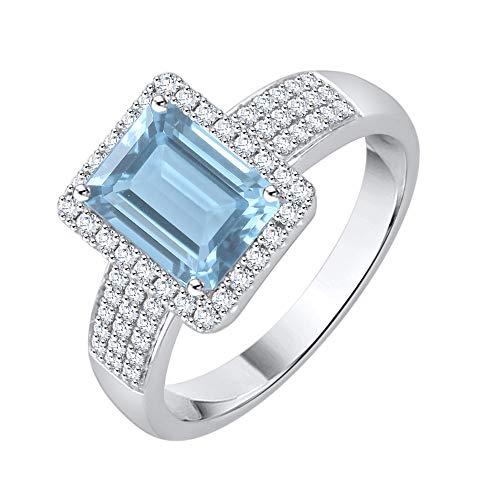 KATARINA Anillo de halo de topacio azul de talla esmeralda y diamantes en oro de 14 k (1 1/10 cttw, J-K, SI2-I1)