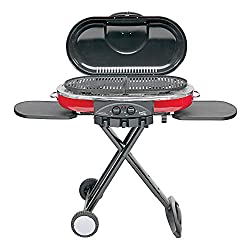 This camp grill photo shows the Coleman Roadtrip LXE Propane Portable Grill.